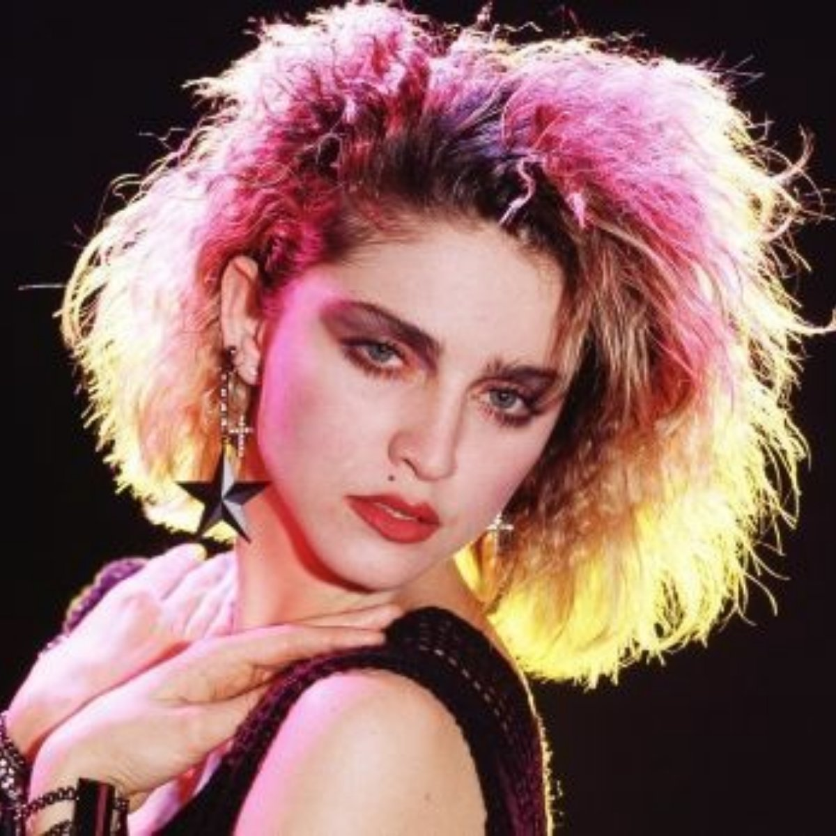 Image of Madonna with pink hair from the 1980s