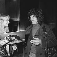 George Harrison with a fan outside the Hilton Hotel Amsterdam February 1977